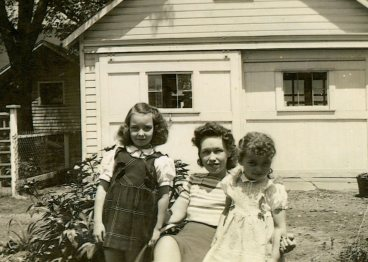 Ruby with girls in the backyard at Frye, c. mid-1940s